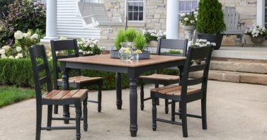square-table-with-four-chairs-in-outdoor-living-space-behind-house