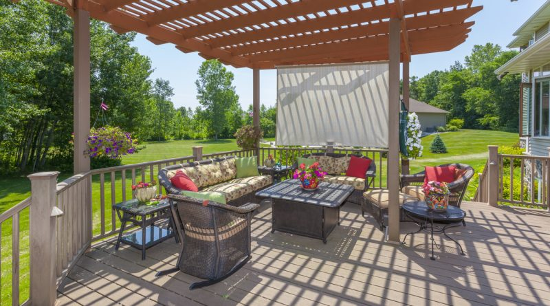 backyard-patio-with-chairs-table-and-shady-pergola
