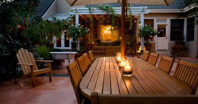 wooden-patio-furniture-set-with-long-table-and-chairs-and-canvas-umbrella