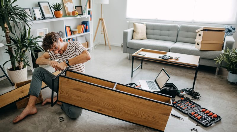 Assembling a table purchased from the Wayfair 2021 Black Friday deals.