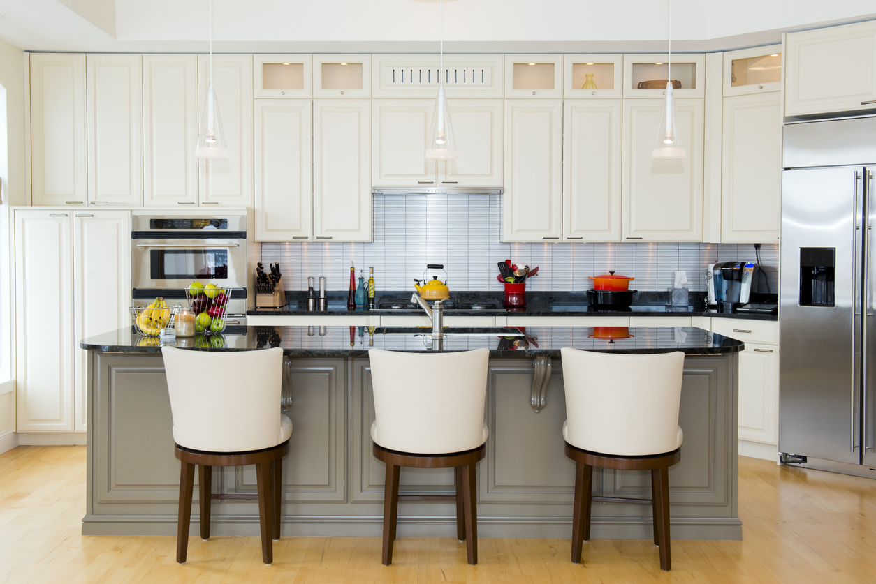 A modern new kitchen featuring new barstools form the Kelly Clarkson Collection at Wayfair.